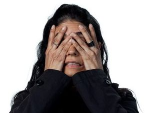 woman with hands over her face